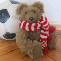 Густав, мишка в шарфе