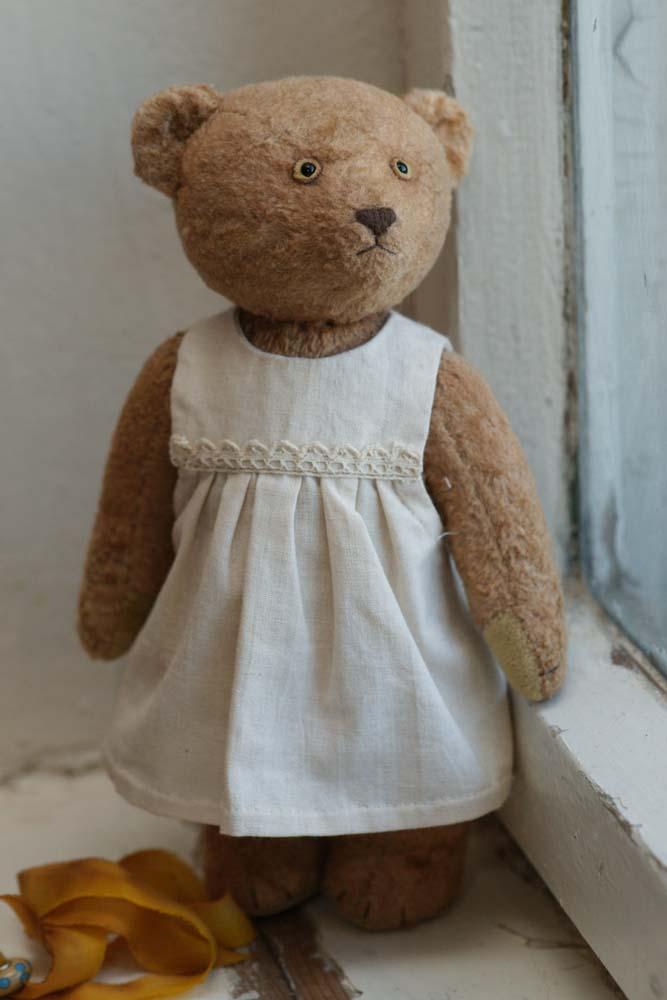 Мишка тедди в платье с кружевом.