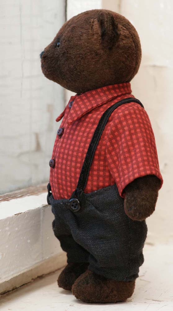 Teddy bear in the pants with suspenders.