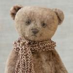 Ретро мишка с опилками и в шарфе.