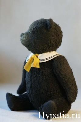 Купить чёрного плюшевого мишку.