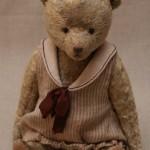 мишка антик в полосатом платье с бордовым шёлковым бантом