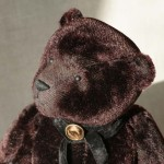black antiq teddy bear in English stile