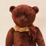 Коллекционный медведь с опилками.
