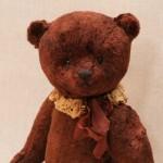 Плюшевый ретро медведь с опилками.