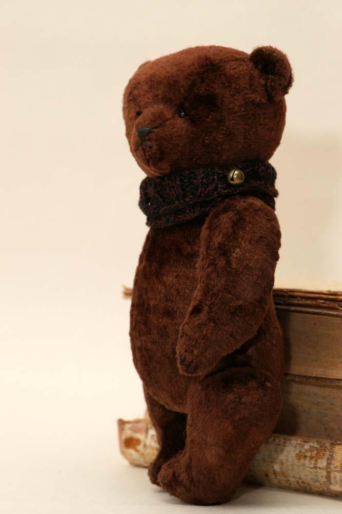 Плюшевый медведь с опилками.